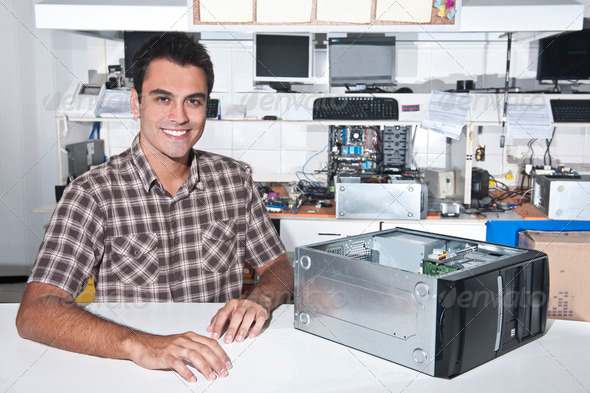 PhotoDune Happy owner of a computer repair store 2562365