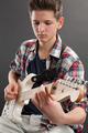 Teenager practicing electric guitar - PhotoDune Item for Sale