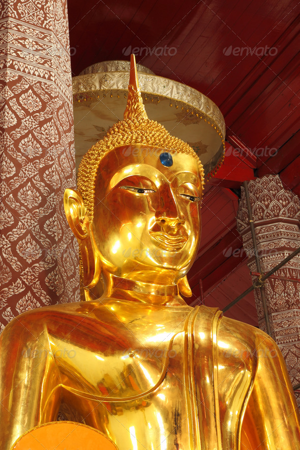 Golden Buddha statue in church. - Stock Photo - Images