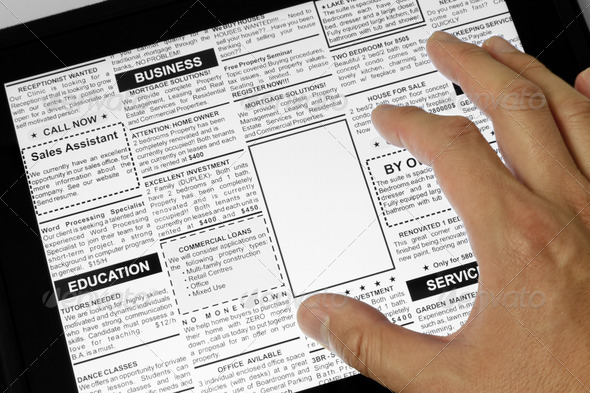 Touchpad and newspaper - Stock Photo - Images
