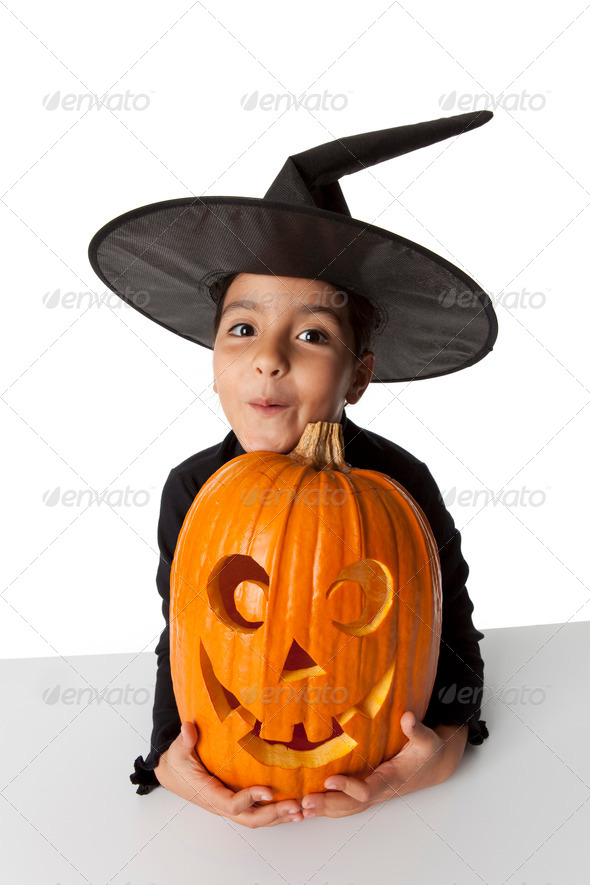 Funny little girl with a Halloween pumpkin - Stock Photo - Images