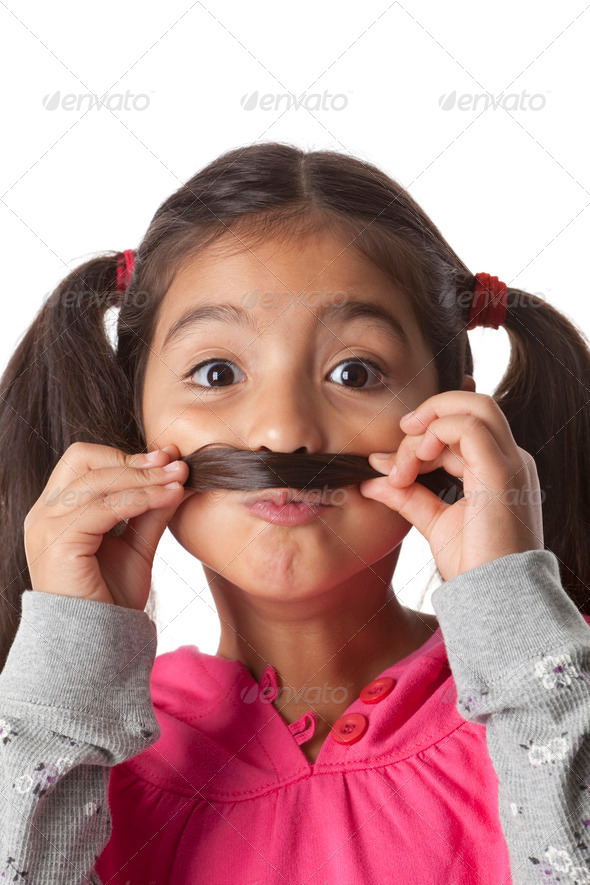 Little girl is making a moustache of her hair - Stock Photo - Images