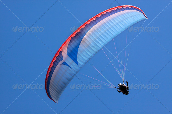 Paraglider in blue sky - Stock Photo - Images
