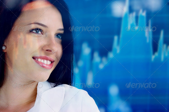 Young woman looking at a stock chart - Stock Photo - Images