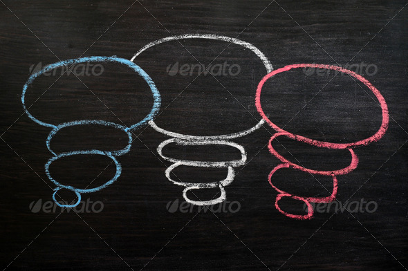 Blank speech bubbles drawn in chalk on a blackboard  - Stock Photo - Images