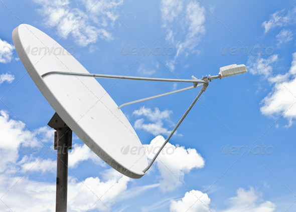 satellite dish and blue sky - Stock Photo - Images