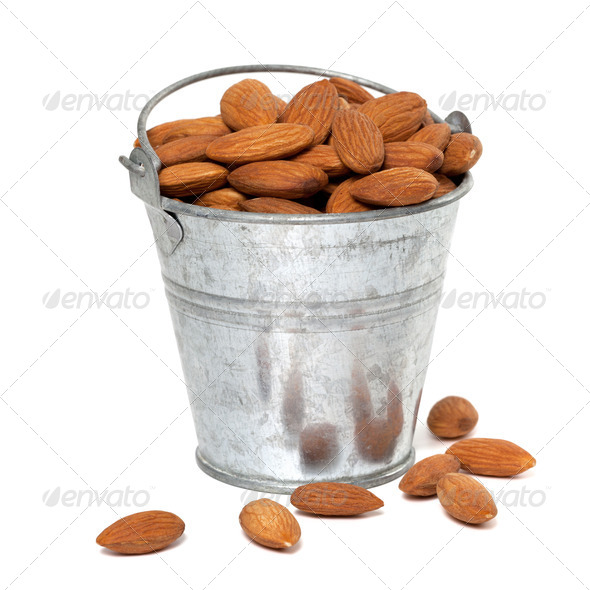 Tin bucket full of almonds - Stock Photo - Images