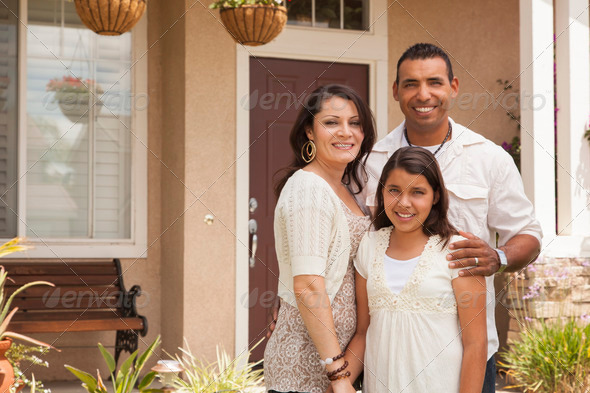 PhotoDune Hispanic Mother Father and Daughter in Front of Their Home 2585425