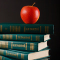 Fresh red organic apple on a top of books - PhotoDune Item for Sale