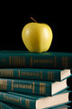 apple over books on black background - PhotoDune Item for Sale