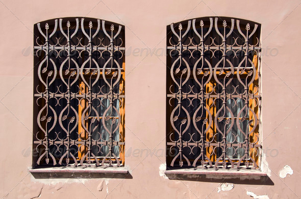 two old windows with metal gratings - Stock Photo - Images