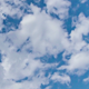 White Fluffy Clouds Over Blue Sky - VideoHive Item for Sale