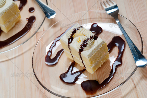 fresh cream cake closeup with chocolate sauce - Stock Photo - Images