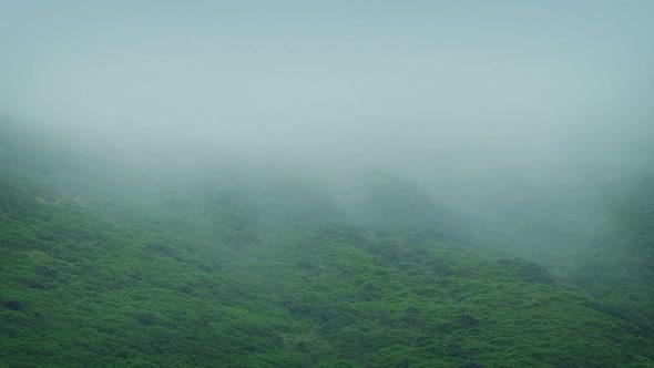 Download Mist Rolls Across Rugged Hillside nulled download
