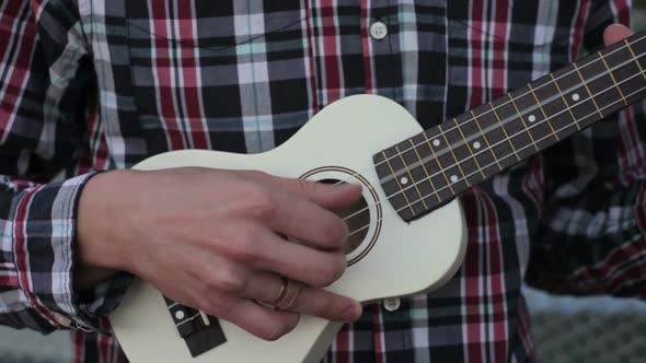 Download Young Man Plays Guitar – Ukulele nulled download