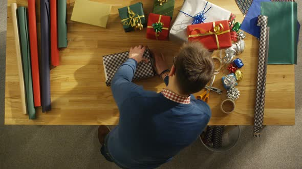 VideoHive 17 04 38 Topview Man Packing Gifsts On Desk Fast Motion 1 19457562