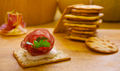 Pile of crackers with one served with Italian meat - PhotoDune Item for Sale