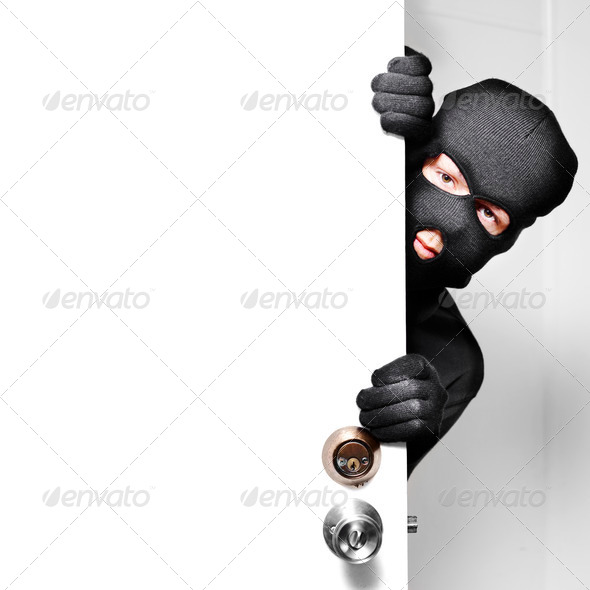 PhotoDune Home burglar opening house door with copyspace 2600148