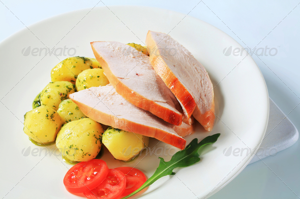 Roast turkey breast and potatoes - Stock Photo - Images