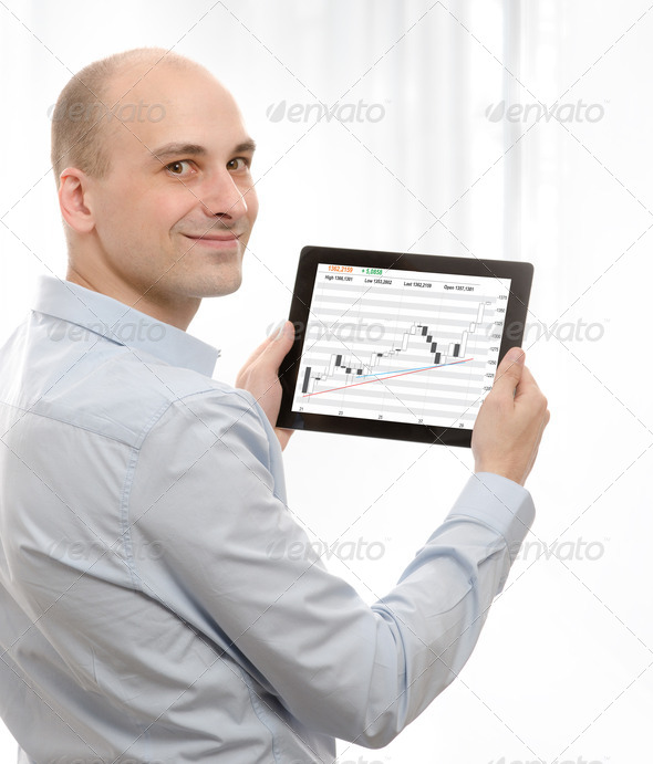 business man using a touch screen device - Stock Photo - Images