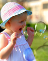 Little girl having fun with soap bubbles - PhotoDune Item for Sale