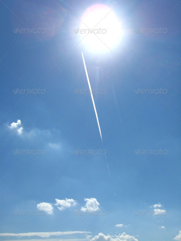 The bright blue sky and the sun - Stock Photo - Images