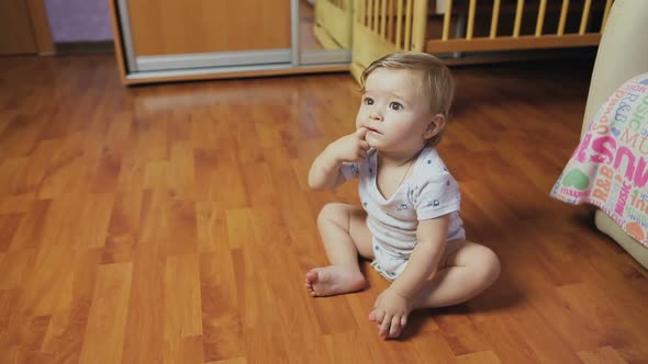 Download Baby boy sitting on the floor in the room. nulled download