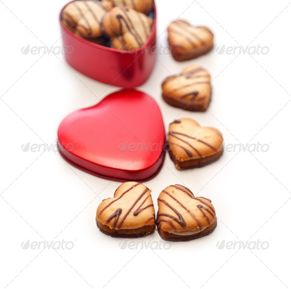 heart shaped cream cookies on red heart metal box - Stock Photo - Images