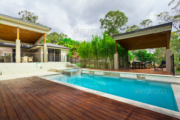 Modern backyard with pool - Stock Photo - Images
