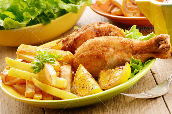 Fried drumsticks with french fries - Stock Photo - Images