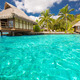 Over water bungalows with steps into blue lagoon - PhotoDune Item for Sale
