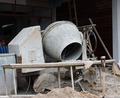 Industrial cement mixer machinery at construction site - PhotoDune Item for Sale
