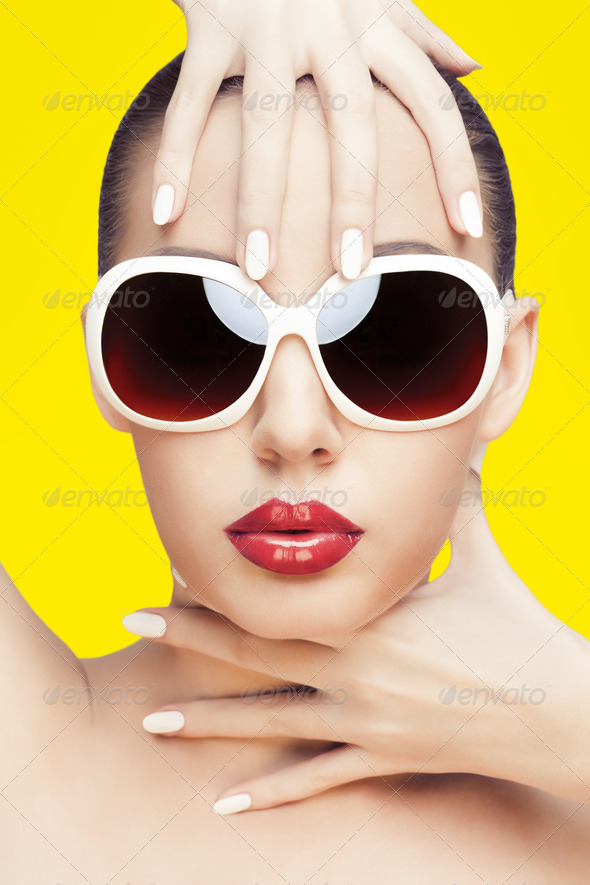 young woman wearing sunglasses - Stock Photo - Images