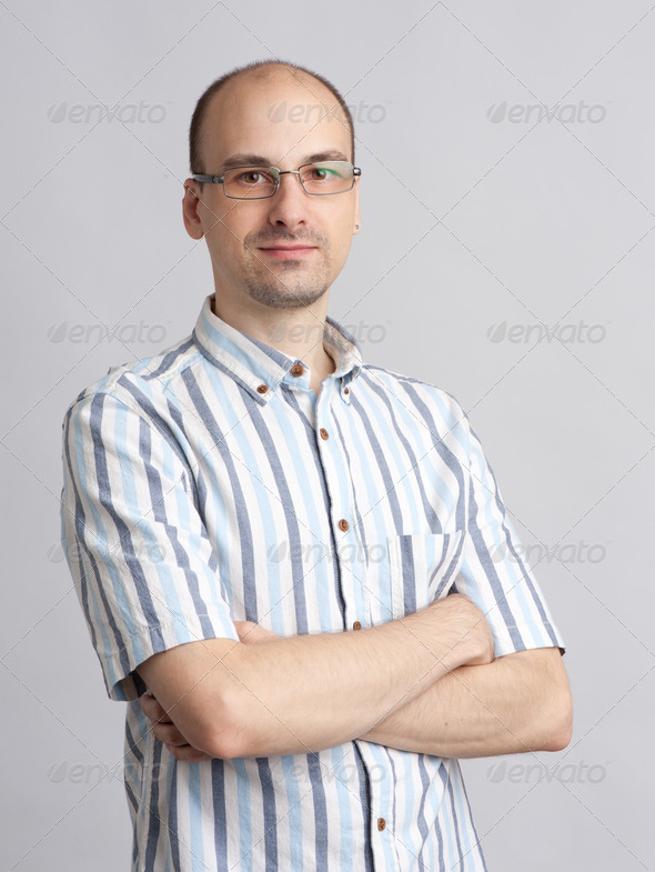 Young unshaved man with glasses - Stock Photo - Images
