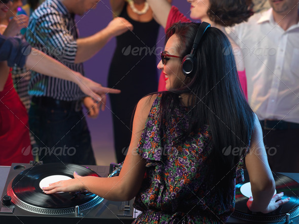 woman dj entertaining crowd in night club - Stock Photo - Images