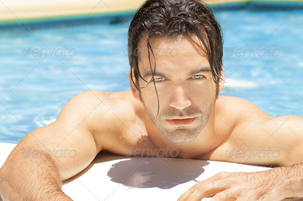Hot sexy guy in pool - Stock Photo - Images