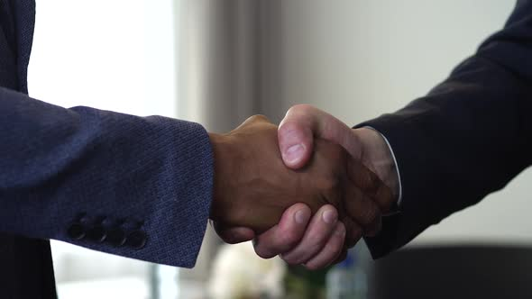 Download Handshake of Two Businessman - is the Completion of the Transaction nulled download