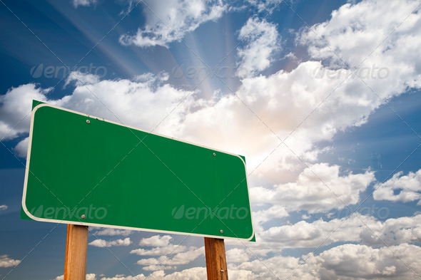 PhotoDune Blank Green Road Sign Over Clouds and Sunburst 298422