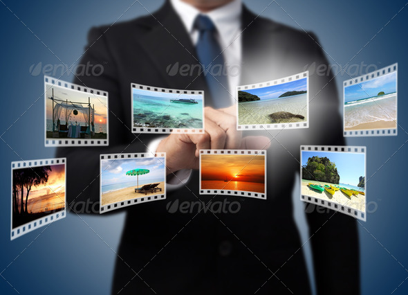 Businessman pushing many image in film button on the whiteboard. - Stock Photo - Images