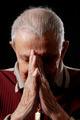 Grandfather in prayer