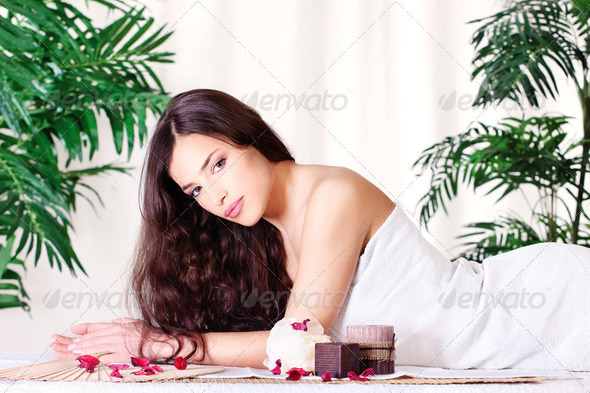 woman on the massage table - Stock Photo - Images