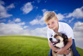 Handsome Young Boy Playing with His Dog in the Grass - PhotoDune Item for Sale