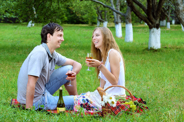 Young couple at picnic - Stock Photo - Images