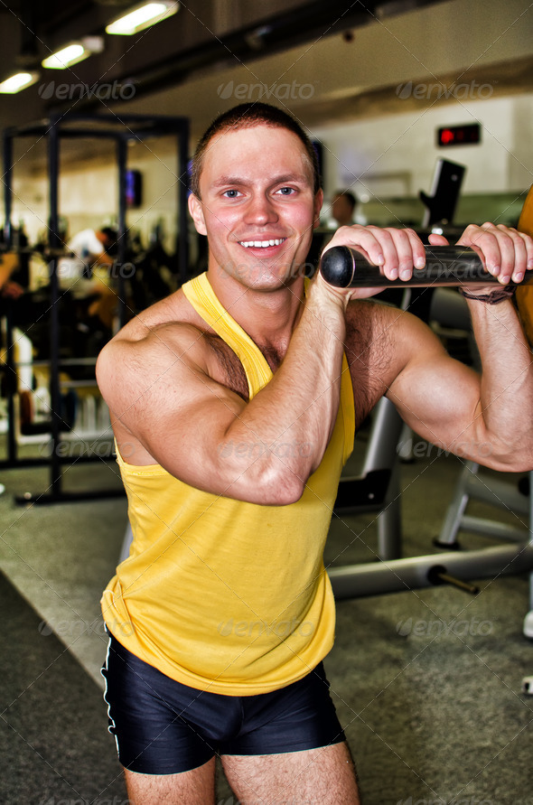 Portrait of handsome bodybuilder in fitness club - Stock Photo - Images