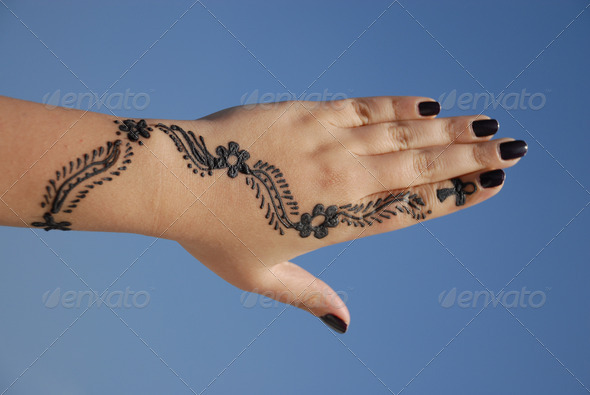 a design on hands against a blue background - Stock Photo - Images
