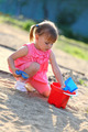 Girl playing alone in the sandpit - PhotoDune Item for Sale