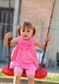 Happy little girl on a swing - PhotoDune Item for Sale