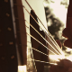 Slow Motion Closeup Of A Hand Playing Guitar - VideoHive Item for Sale