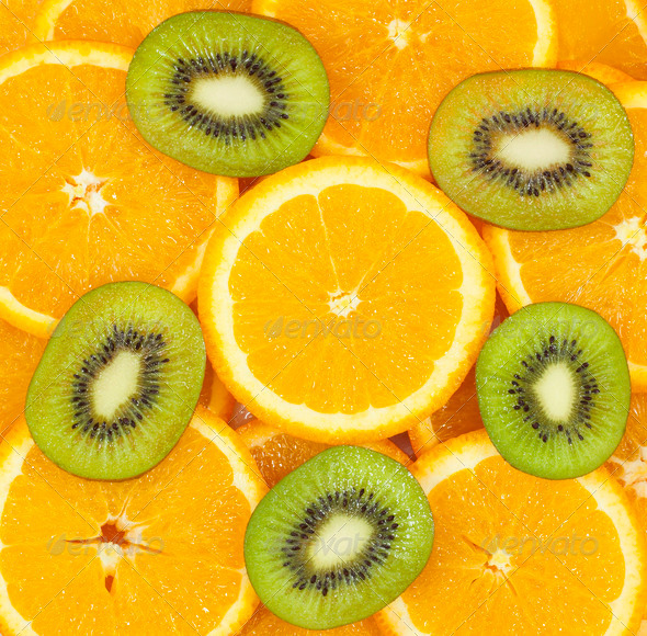 sliced kiwi fruit and citrus orange background - Stock Photo - Images
