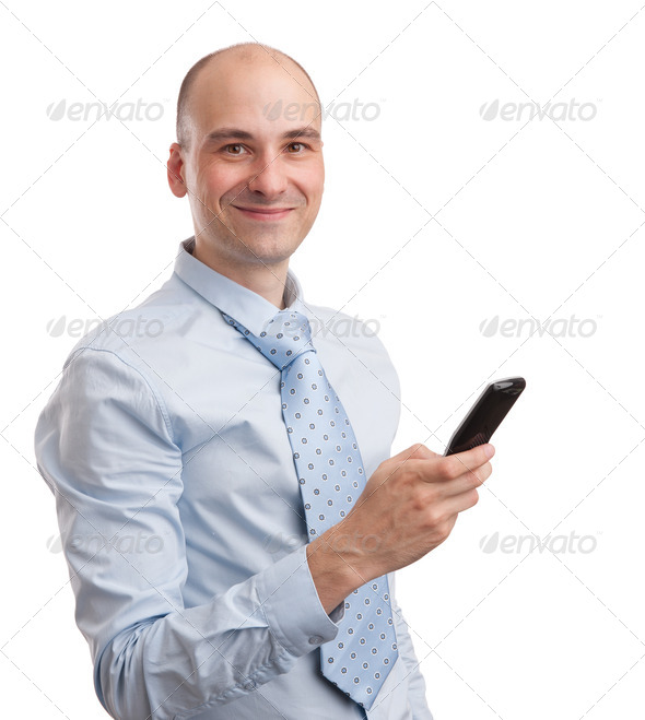 Young smiling businessman with mobile phone - Stock Photo - Images